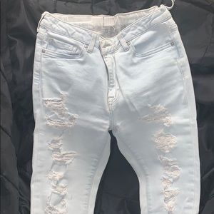 Super distressed light wash jeans, ankle cut